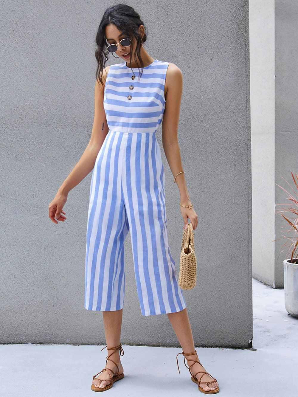 Flat sandals as a type of shoe to wear with jumpsuit