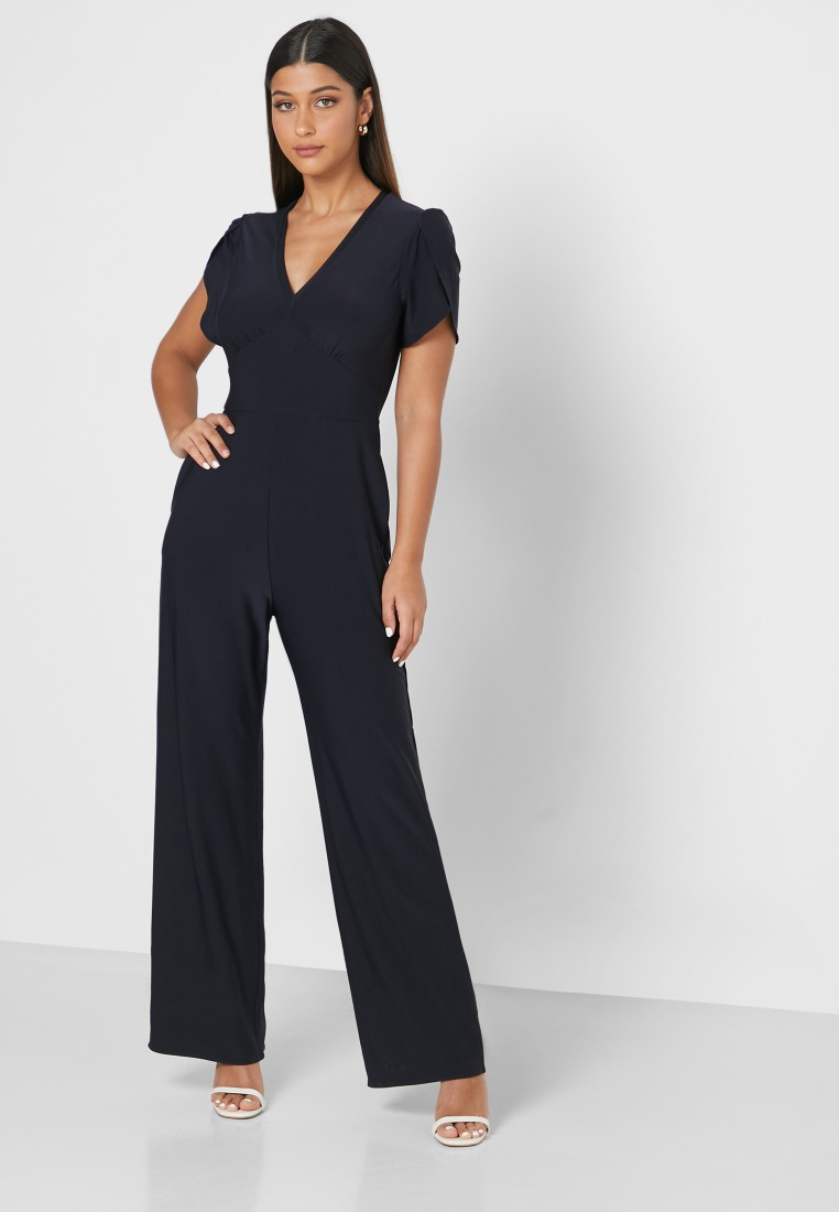 Sandals as a type of shoe to wear with a jumpsuit
